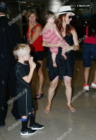 Editorial image of Poppy Montgomery and children at LAX International Airport, Los Angeles, America - 01 Aug 2014