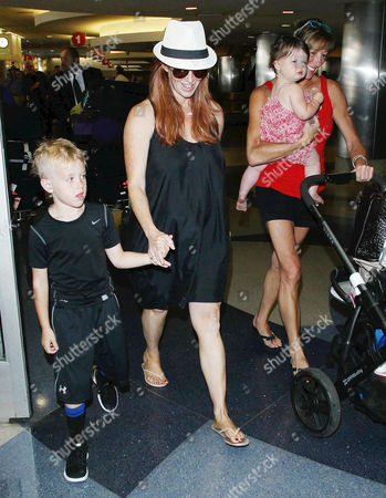 Stock Picture of Poppy Montgomery and children Jackson Kaufman and Violet Sanford