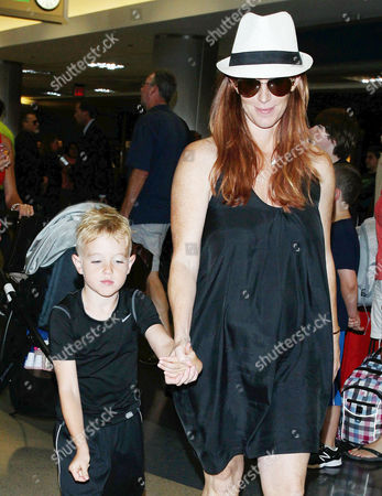 Stock Picture of Poppy Montgomery and son Jackson Kaufman