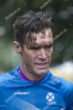 Scotlands David Millar finished in 11th place in the Men's Road Race Out of 140 competitors only 12 finished the 104 mile  race in often torrential rain through the streets of Glasgow .