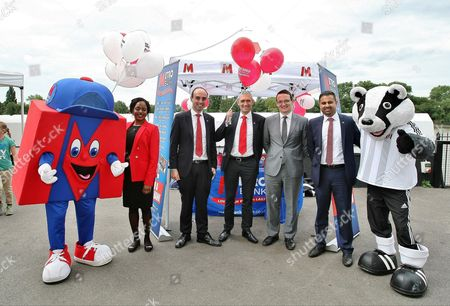 CEO of Metro Bank Craig Donaldson pose for a picture with Fulham FC representatives, Metro Bank representatives and mascots : Metro Man and Billy the Badger