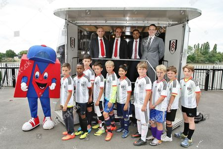 Merto Man,Merto Bank representatives, CEO of Metro Bank Craig Donaldson, Fulham FC representative and Fulham fans pose for a picture at the Foundation trailer