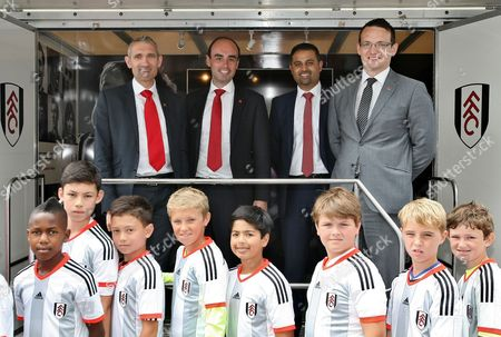 Merto Bank representatives, CEO of Metro Bank Craig Donaldson, Fulham FC representative and Fulham fans pose for a picture at the Foundation trailer