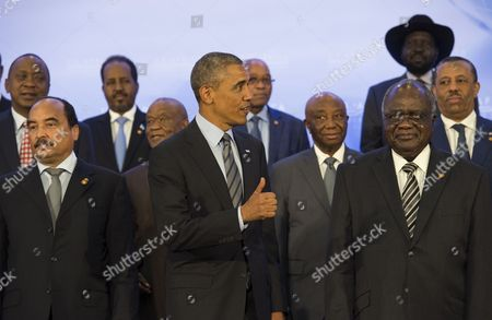 United States President Barack Obama takes part in the family photo at the Africa Leaders Summit, standing in between Mohamed Ould Abdel Aziz, President of the Islamic Republic of Mauritania (Left) and Hifikepunye Pohamba, President of the Republic of Namibia (Right)