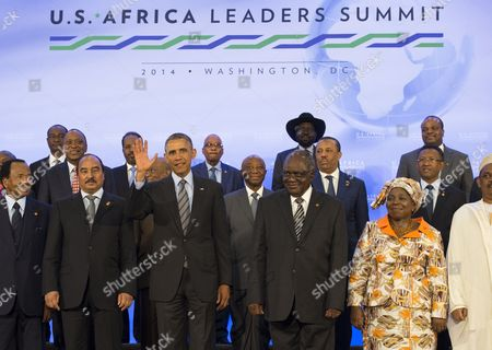 United States President Barack Obama takes part in the family photo at the Africa Leaders Summit, standing in between Mohamed Ould Abdel Aziz, President of the Islamic Republic of Mauritania (2nd Left) and Hifikepunye Pohamba, President of the Republic of Namibia (3rd Right)