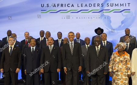United States President Barack Obama takes part in the family photo at the Africa Leaders Summit, standing in between Mohamed Ould Abdel Aziz, President of the Islamic Republic of Mauritania (3rd Left) and Hifikepunye Pohamba, President of the Republic of Namibia (2nd Right)