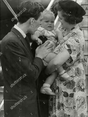 The Father Of Barry James Nixon Says Goodbye To His Son As An Air Hostess Holds Him In Her Arms. Barry Is To Live With An Aunt In Canada After Death Of His Mother.