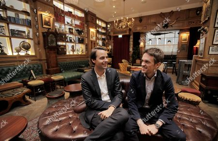 Stock Photo of Charlie Gilkes, left, and Duncan Stirling, founders of bar and club empire Inception Group at their central London bar 'Mr Foggs'