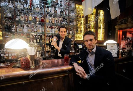 Stock Image of Charlie Gilkes, left, and Duncan Stirling, founders of bar and club empire Inception Group at their central London bar 'Mr Foggs'