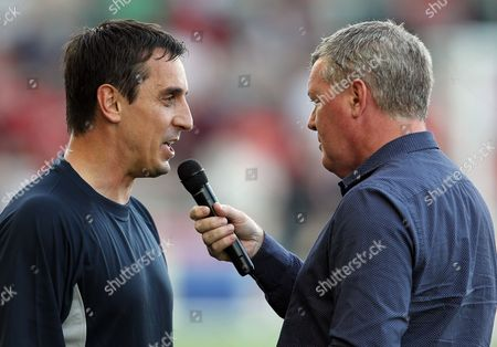 Gary Neville of Manchester United Class of 92 is interviewed by Geoff Shreeves before the game