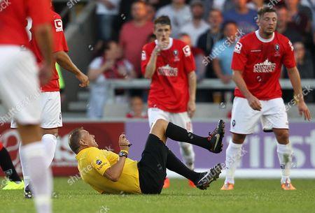 Referee Mr Mark Halsey gets knocked over
