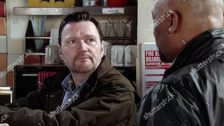 Stock Image of Seeing no alternative, Owen Armstrong [IAN PULESTON-DAVIES] accepts Tony 's [TERRENCE MAYNARD] paltry offer for the business.  Picture contact: david.crook@itv.com on 0161 952 6214