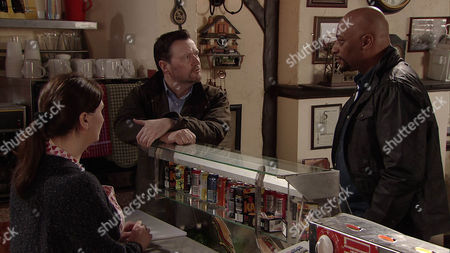 Stock Picture of Seeing no alternative, Owen Armstrong [IAN PULESTON-DAVIES] accepts Tony 's [TERRENCE MAYNARD] paltry offer for the business.
