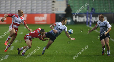Cardiff Blues' Thomas Williams releases the ball to Cardiff Blues' Dan Fish during their Semi Final match against Gloucester