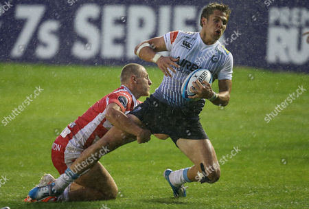 Cardiff Blues' Thomas Williams is tackled by Gloucester's Callum Braley during the Semi Final match
