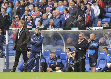 Robbie Neilson manager of Hearts waits for the final whistle (L) while Ally McCoist manager of Rangers (R) looks dejected