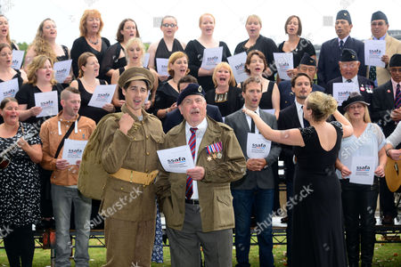 Re-enactor Jack Monaghan and D-Day Veteran Bill Aitkenhead perform with Military Wives, Blake, Jonjo Kerr, and attend