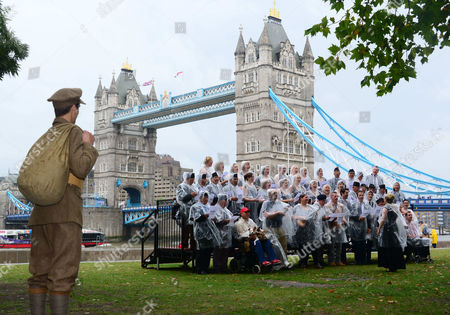 Re-enactor Jack Monaghan watches on as Military Wives, Blake, Jonjo Kerr, perform and attend