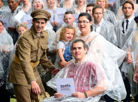 Re-enactor Jack Monaghan, RAF Regiment Lance Corporal Kevin Ogilvie, his wife Amie and daughter Grace, age 2, perform with Military Wives, Blake, Jonjo Kerr, and attend