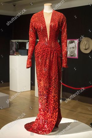 """A red sequinned evening gown made for Marylin Monroe as Lorelei Lee in the 1953 20th Century Fox film Gentlemen Prefer Blondes, was designed by William Travilla and was worn by Monroe and Jane Russell for the opening number """"Two Little Girls from Little Rock."""""""