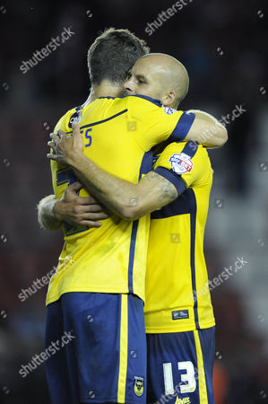 Oxford United's David Hunt celebrates Oxfords late win with Oxford United's Jonathan Meades