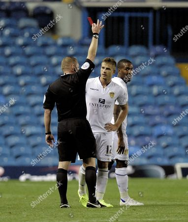 Gaetano Berardi of Leeds United is sent off by referee Richard Clark
