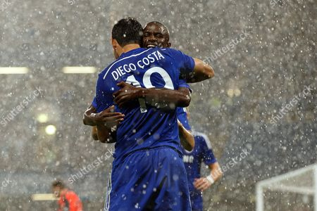 Diego Costa of Chelsea celebrates scoring a goal with Ramires after making it 1-0