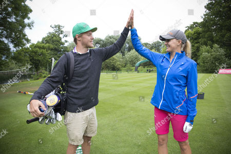 Stock Image of Caroline Martens, with her younger brother Casper, who is currently her caddie.
