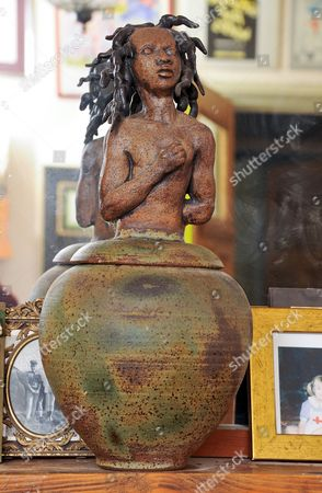 An earthenware bowl and statue lid