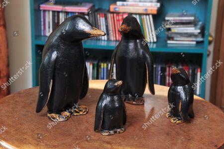 A Family of Model Wooden Penguins