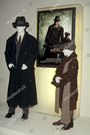 COSTUMES FROM THE FILM 'ROAD TO PERDITION'. DESIGNER ALBERT WOLSKY. WORN BY (L TO R) TOM HANKS AND TYLER HOECHLIN.