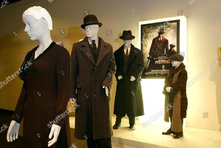 COSTUMES FROM THE FILM 'ROAD TO PERDITION'. DESIGNER ALBERT WOLSKY. WORN BY (L TO R) JENNIFER JASON LEIGH, JUDE LAW, TOM HANKS AND TYLER HOECHLIN.