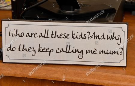 """He's fostered about 50 children a humorous plaque saying """"Who are all these kids and why do they keep calling me Mum?"""""""