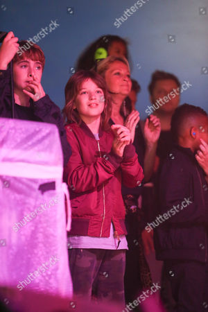 Gene Gallagher and Ace Billy Howlett watch their mothers (Nicole and Natalie Appleton) perform with All Saints
