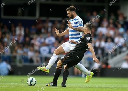 James Chester of Hull City battles with Charlie Austin of Queens Park Rangers FC