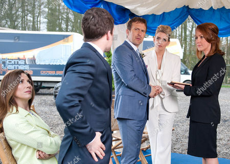 In a gazebo outside Home Farm Charity Sharma [EMMA ATKINS] and Declan Macey's [JASON MERRELLS] small wedding service begins. With just Megan Macey [GAYNOR FAYE], Robbie Lawson [JAMIE SHELTON], Noah  Sharma [JACK DOWNHAM] and the Registrar in attendance it's a low-key affair. But it seems Megan is doing all she can to sabotage the ceremony. Just as the wedding rings are needed they are found to be missing and Robbie leaves to track them down, whilst Charity looks for an alternative solution.  When the fire alarm suddenly goes off, the registrar is interrupted just at the point before she is able to pronounce them husband and wife. The penny drops for Charity that Megan is behind the day's antics. Charity is swift to throw a punch but will she tie the knot?