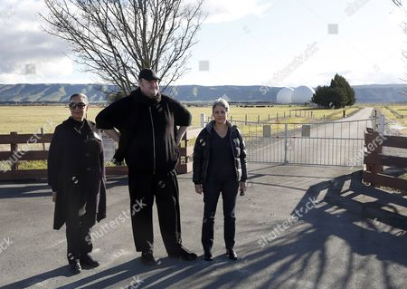 Internet entrepreneur and political party backer Kim Dotcom with Internet Mana political party leader Laila HarrŽ and candidate Georgina Beyer (L) visiting the Waihopai spy base run by the GCSB near Blenheim which is part of ÔEchelonÕ an international network run by the NSA in the USA