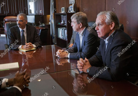 US Attorney General Eric Holder (lt) during his meeting with US Sen. Roy Blunt, R-Mo (centre) Missouri Gov. Jay Nixon (rt) and other elected officials at the US Attorney's office in St. Louis