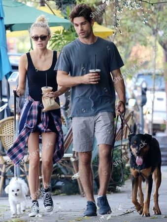 Melissa Ordway and Justin Gaston walk their dogs