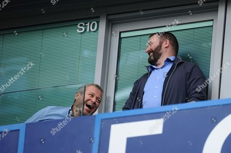 Chelsea owner Roman Abramovich laughs in his box after his side's second goal
