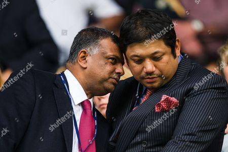 QPR Chairman Tony Fernandes talks with co-owner Ruben Emir Gnanalingam