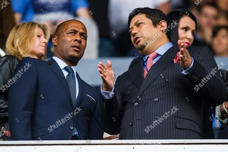Les Ferdinand talks with QPR co-owner Ruben Emir Gnanalingam