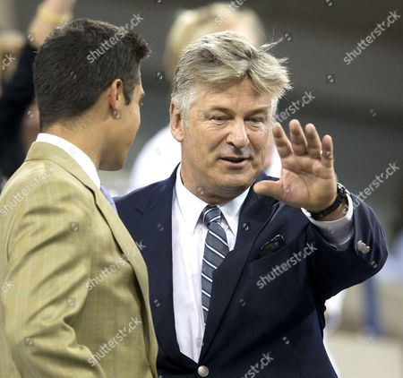 Actor Alec Baldwin in the USTA President's Box watching Maria Sharapova and Maria Kirilenko of Russia in the first round