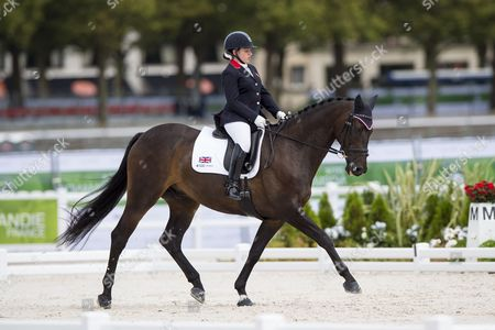 Natasha Baker and Cabral winning silver during the Individual Test Grade II Para Dressage - Alltech FEI World Equestrian Gamesª 2014 - Normandy, France.