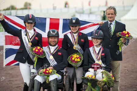 Team GBR World Champion Team Test Para Dressage team members Sophie Wells, Lee Pearson, Natasha Baker, Sophie Cristiansen - Alltech FEI World Equestrian Gamesª 2014 - Normandy, France.