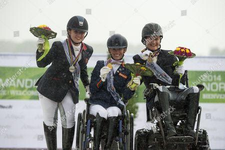 Podium Para Dressage Individual Competition Grade II 1. Rixt van der Horst and Uniek, 2. Natasha Baker and Cabral, 3. Lauren Barwick and Off to Paris - Alltech FEI World Equestrian Gamesª 2014 - Normandy, France.