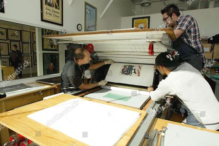 Stock Picture of RAY MAZZ AND ERIC DOMENECH WITH THE 1870'S MARIONI VOIRIN LITHOGRAPHY PRESS.
