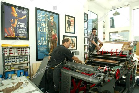 RAY MAZZ AND ERIC DOMENECH WITH THE 1870'S MARIONI VOIRIN LITHOGRAPHY PRESS.