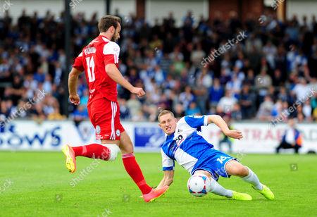 Bristol Rovers' Dave Martin challenges FC Halifax Town's Richard Peniket