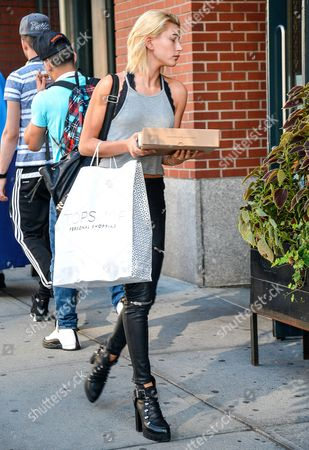 Hailey Baldwin with a box of doughnuts